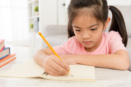 440x293px Asian Primary Girl Studying